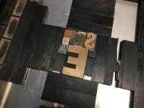 vintage wood type locked up on the Vandercook press bed